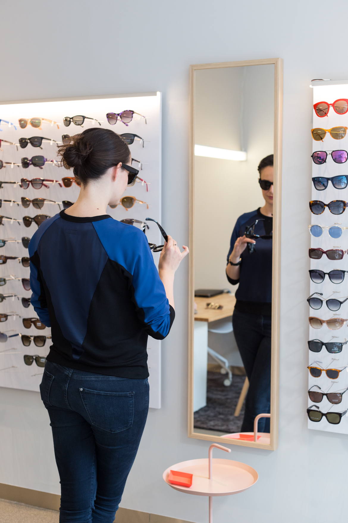 Choosing new sunglasses at De Wolf Opticiens